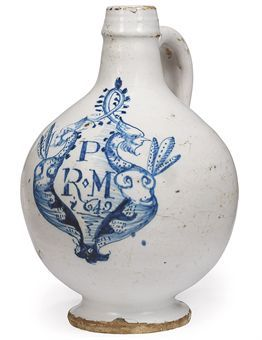 AN LONDON DELFT DATED BLUE AND WHITE WINE-BOTTLE 1642, PROBABLY SOUTHWARK Of conventional type, painted with the initials P/R.M and the date 1642 with a flourish below within a stylised caryatid and foliage cartouche 7½ in. (19 cm.) high