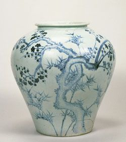 """Records reveal that court painters were deployed to the official kiln """"Buwong"""" to execute the blue-and-white painted decoration. By the 16th century, while still modeling on the motifs of the Chinese blue-and-white, the court painters contributed to render the richness of fresh fragrance on the motifs, the expression unique to Joseon dynasty. In this piece two branches of a plum tree intersecting and extending towards opposite directions are dexterously depicted. The plum blossoms are painted in"""