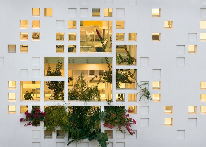 Jean Nouvel's Cyprus tower features perforated walls filled with plants