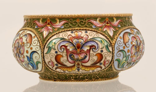 A Russian silver gilt and shaded cloisonne enamel bowl, Feodor Ruckert, Moscow, 1896-1908. The circular bowl with raised oval lobes decorated in shaded multi-color floral and foliate motifs with alternating grounds of pale blue, cream and peach against an overall olive green ground. 88 silver standard.