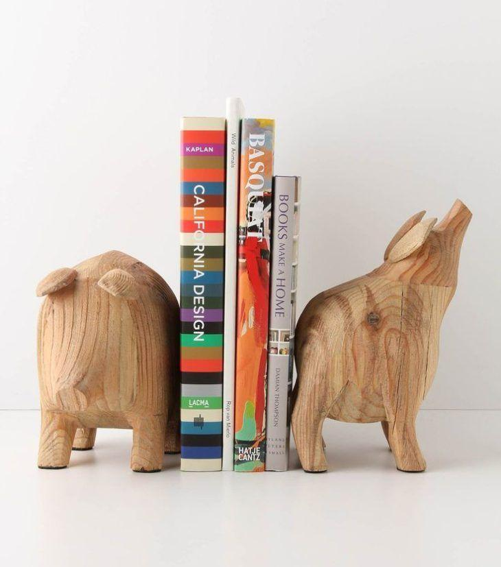 While wooden piggies may not be the first thing you imagine for the task of holding your books in place, who can resist the Potbelly Bookends by Roost from Anthropologie? These hand-carved pine items are stylishly primitive in their appearance.