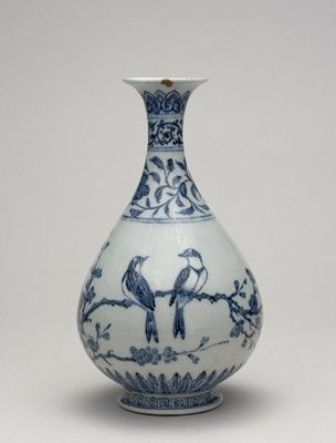 China, possibly Yongle; Ming dynasty (1403-1424), Jiangxi (province), Jingdezhen. Porcelain bottle vase of yuhuchun form, with a pear-shaped body, narrow neck and flaring mouth rim.  Decorated in underglaze blue. Band of lingzhi fungi below the mouth rim, plantain leaves and lotus flowers on the neck, and lily plants with a butterfly on the body.  Glazed base.