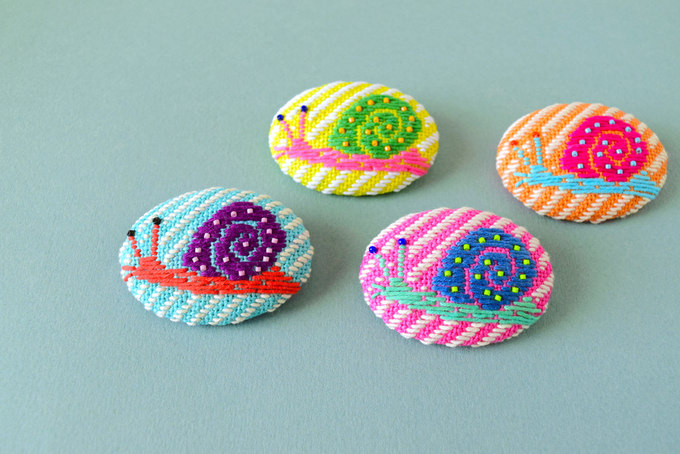 Kogin Embroidered Snail Brooches