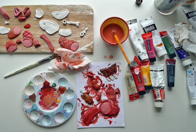 The meats were painted with acrylics, dried, varnished and glued onto the surface of the box. The painting process was rather entertaining as it made my desk look like a butcher's workspace.