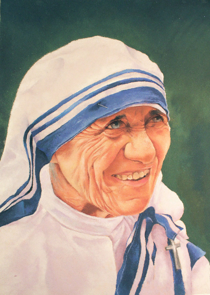 Over the years, the art form has taken a creative bend and there are exhibitions held where the portrait artists come together and try to create portraits using this medium of rangoli powder.This year I had taken part in one group exhibition of portrait rangoli. Here is the picture of my final Rangoli of Mother Teresa