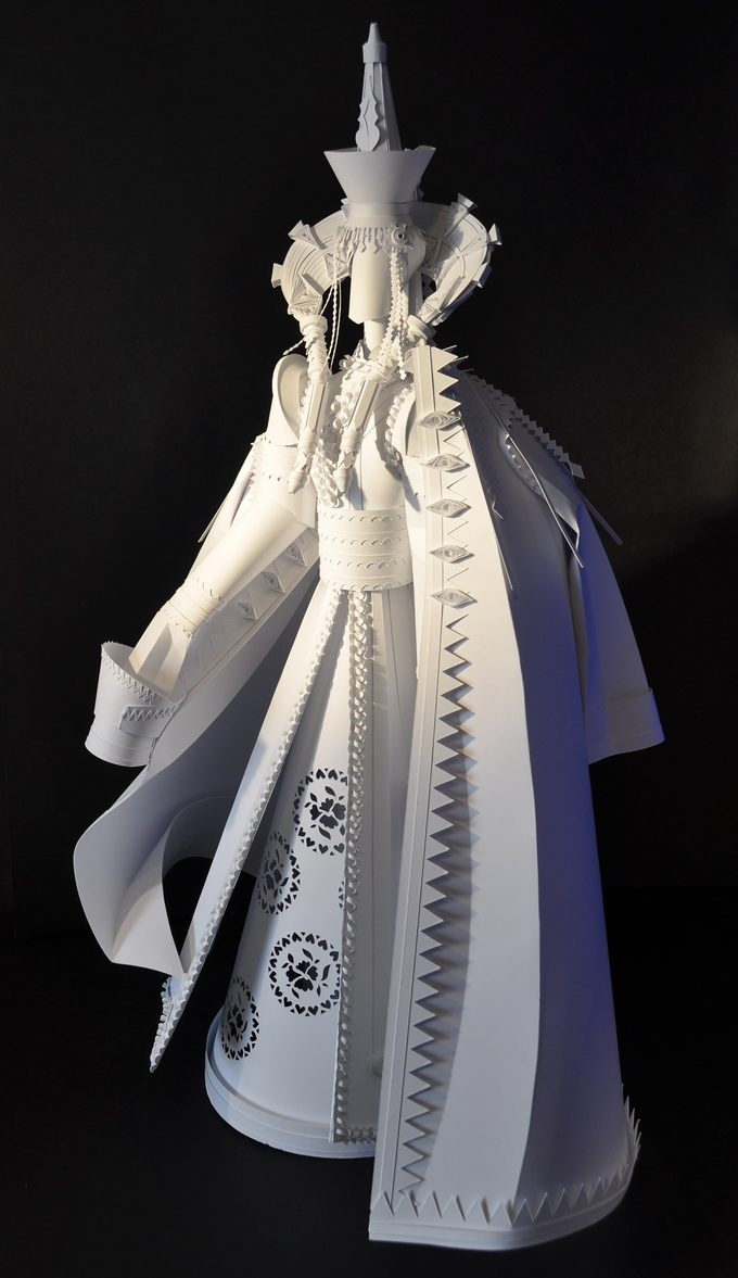 """The project is a series of paper sculptures of brides in various ethnic wedding gear. The artist lays emphasis in specific characteristics of wedding dresses in different countries. Each sculpture expresses the variety and richness of wedding gear and how embodies the most specific characteristics of each national costume. Ethnic wedding dresses are nowadays the dying out tradition. They are preserved mostly in photos, descriptions of ethnologists and fashion historians. So the particular idea of this series is to create the so to call """"Red book of fashion"""".Mongolia"""