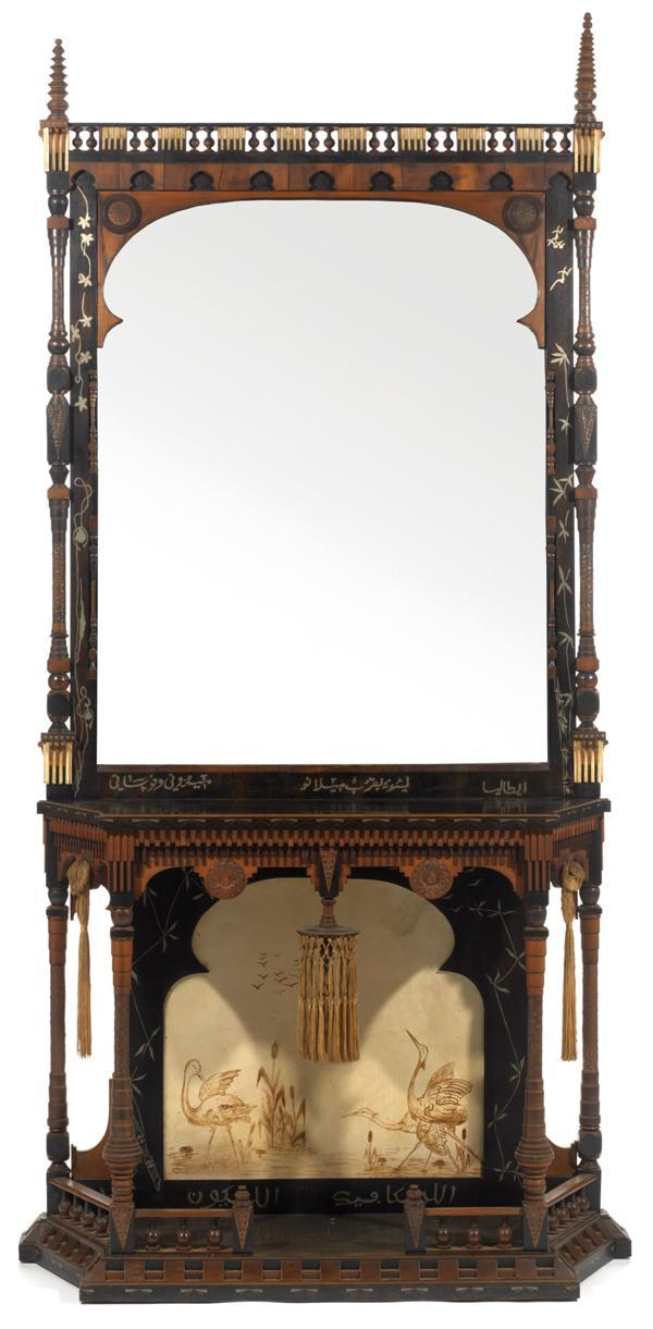 CARLO BUGATTI (1856-1940) & EUGENIO QUARTI (1867-1929) spectaculaire console orientaliste structure en bois noirci, marqueterie et colonnettes, terrasse et plateau rectangulaires à pans coupés, partie inférieure à décor, sur parchemin, d'un paysage au