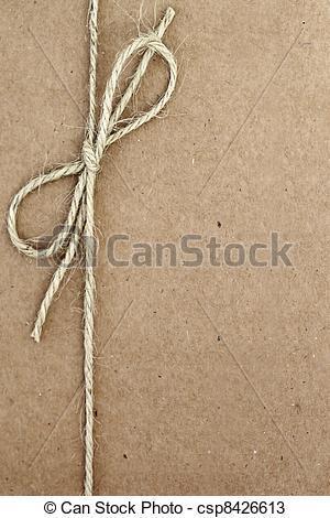 String tied in a bow, over brown paper packaging. 正版图片在线交易平台 - 海洛创意(HelloRF) - 站酷旗下品牌 - Shutterstock中国独家合作伙伴