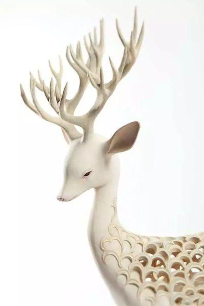 艺术家 Yoshimasa Tsuchiya 的木雕作品