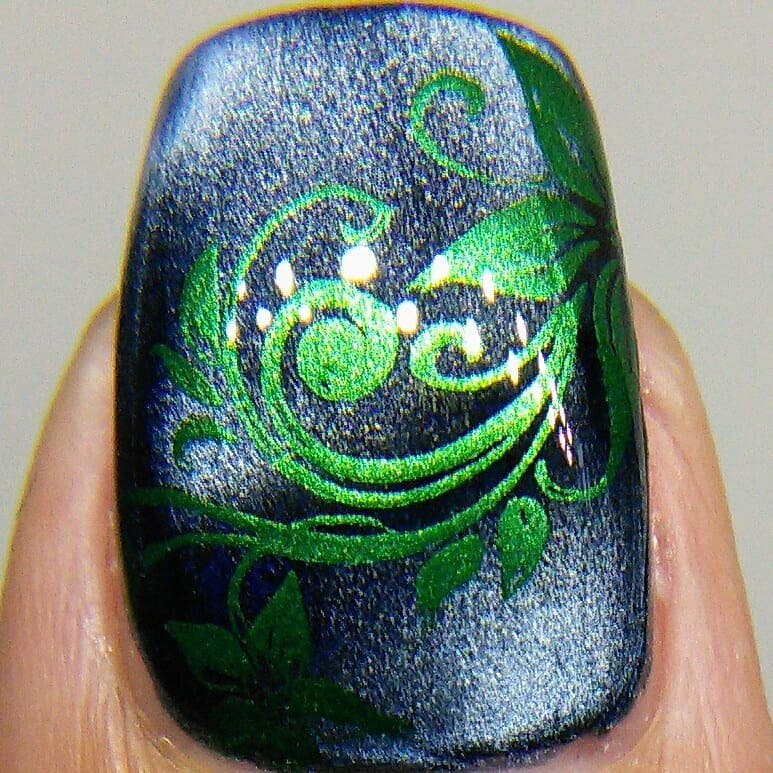 These are the other two colors in the new Queen of Carnival stamping polish collection The gold is called Love Beads and the green Call Me Rex!. I used Twirls and Swirls 01 over a dark blue magnetic polish. Swipe for macros. ***stamping