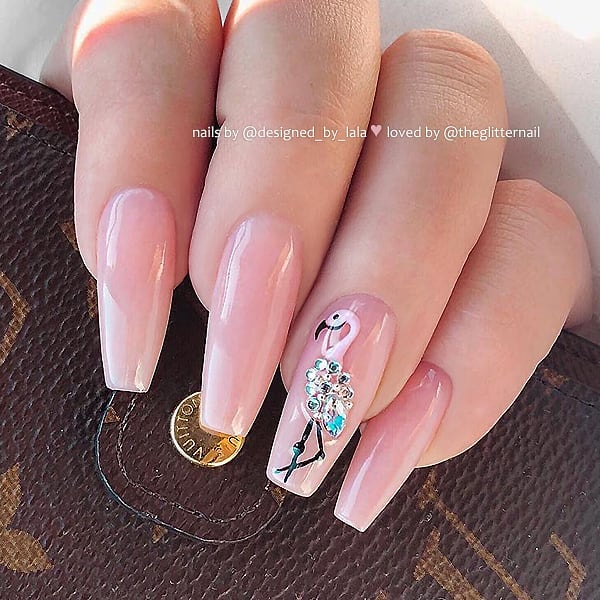 Nude-Rose with Hand Painted Flamingo and Crystals on Coffin Nails  Nail Artist:  Model:  Follow them for more gorgeous nail art designs and makeup looks Turn on post notification, if you don't want to miss any of my posts