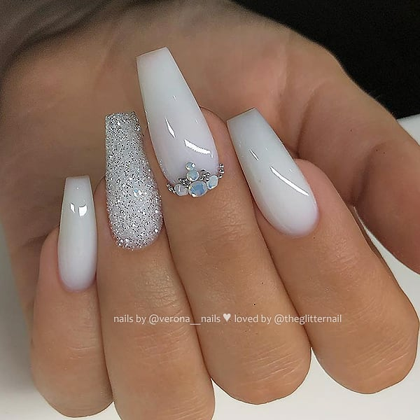 Milky White with Glitter and Crystals on long Coffin Nails  Nail Artist:  Follow her for more gorgeous nail art designs Turn on post notification, if you don't want to miss any of my posts
