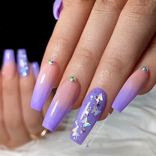 Pastel Purple Ombre with Glitter Butterflies and Crystals on long Coffin Nails  Nail Artist:  Follow her for more gorgeous nail art designs Turn on post notification, if you don't want to miss any of my posts.