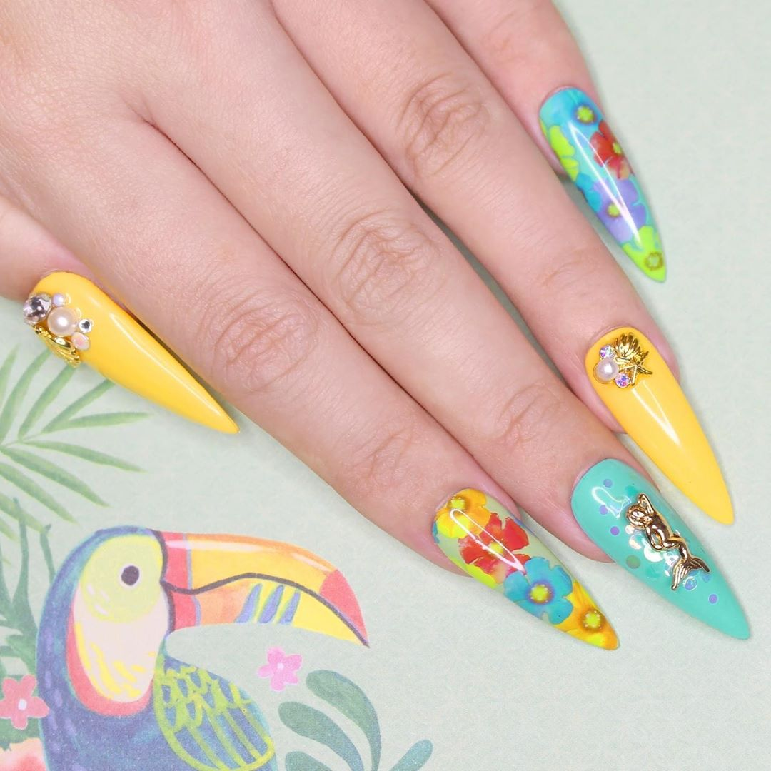 Today marks the official first day of Summer!  What are your summer plans? We want a beach vacation with these tropical nails  ..Featured Products:Charme Gel 603 LemonadeCharme Gel 704 Mermaid TailFoil Transfer Gel  FoilAurora Iridescent Glitter MixMermaid charmSeaside Cluster charmStay Put Gelly Diamond Shine No-Wipe Gel Topcoat ..Nails by for  Shop for featured products at DailyCharme.com  charmegel