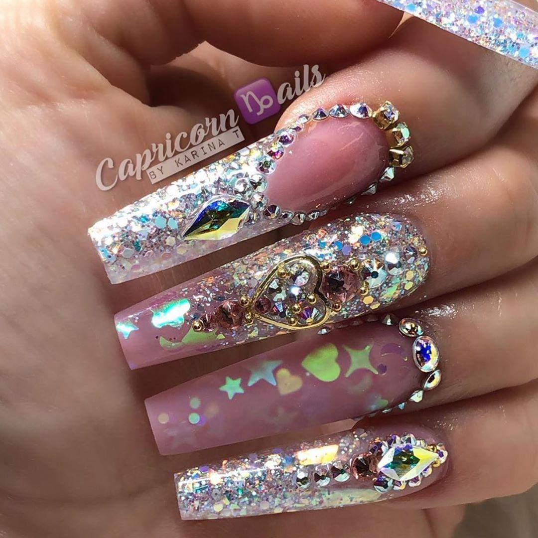 Sailor Moon nails  Nails by Daily Charme Ambassador using Swarovski crystals, pearls, glitters  studs  Shop for nail art goodies at DailyCharme.com ..mattenails