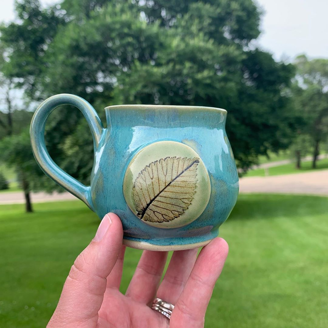 The kiln is cool and the leaf mugs are out! This leaf is an elm  leaf from one of the many elm trees we have on our property.  These were a total experiment and I learned a lot from this batch... cant wait to make more. handmademug