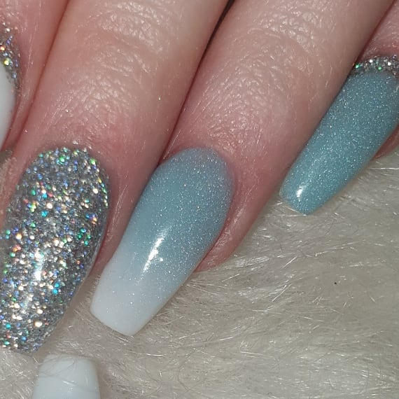In love with this light blue and white with silver glitter cuffs ....bluenails