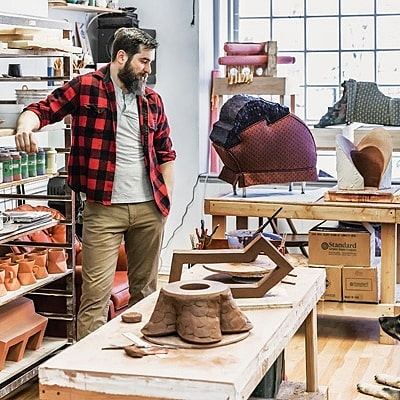 Patrick Coughlin (is our studio visit artist in the JuneJulyAugust 2019 issue of His studio is based in Philadelphia, Pennsylvania. He shows readers how his has laid out his studio to accommodate his need and use of multiple media. He has areas for working with clay, plaster, glaze, wood, and fabric. For more:https:bit.ly2WkJe4J. mixedmedia
