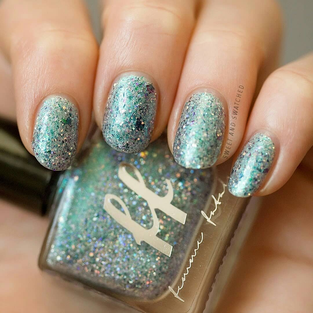 I'm living for Mermaid Candy by from the February Sugar Rush. This polish is everything!!! My only regret is that I don't have one hundred backup bottles.You have to swipe for the macro, I can't stop staring at it!indiepolish