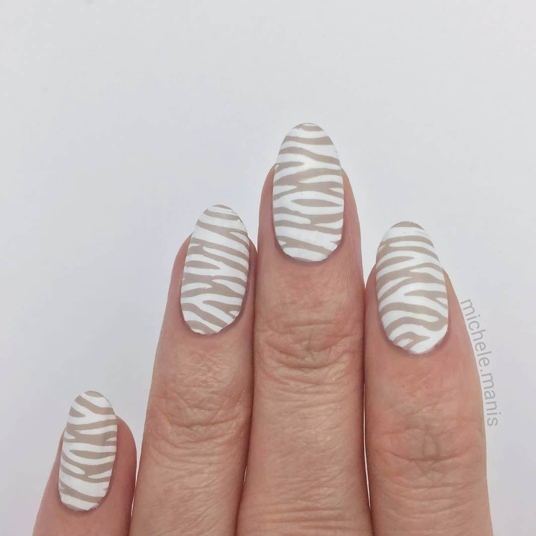 I call this look: Gentle Zebra..----------My ebook guide to nail stamping supplies is available now, link in my bio!- Sand Tropez- Jenny's Gonna Love It stamping polish- Pro XL 04 stamping plateinstanails