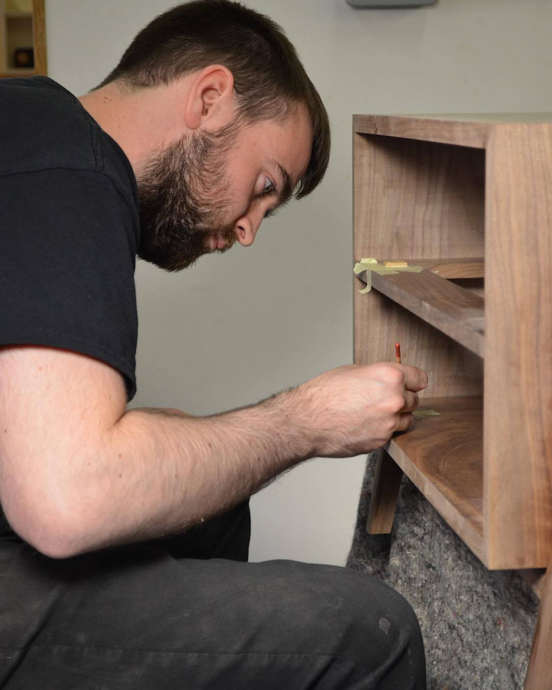 Designer maker student getting very close to finishing his walnut and oak coffee table with piston fit drawers.