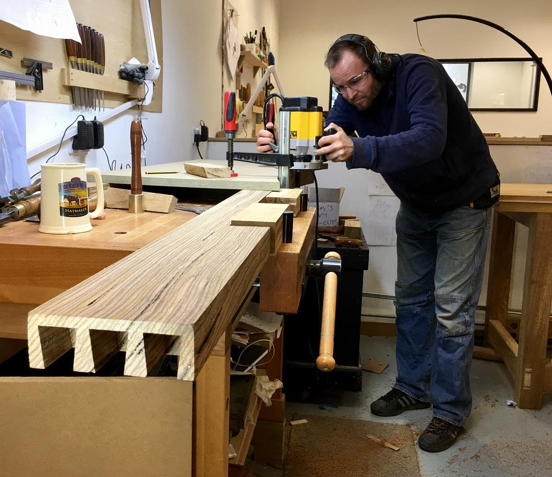 Tom is adding some more decorative flourishes to his zebrano and Iroko bench. There's some serious show joinery featuring too!