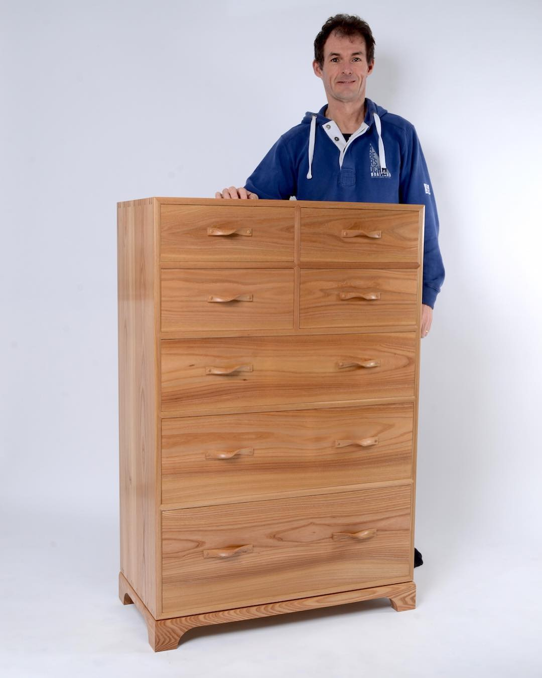 A proud having just completed his first self designed piece. The 'Farfalle' chest.