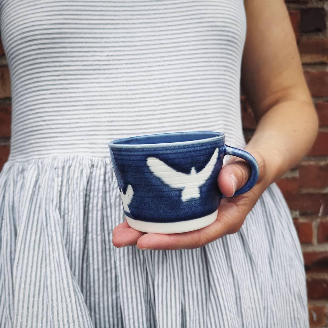 I am a bird girl I've got my heartHere in my hands now...handmade