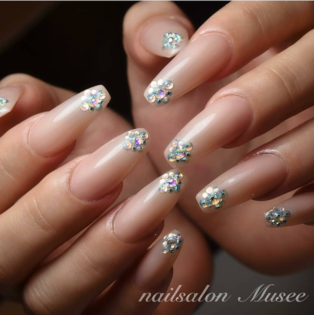 Nude with a touch of Swarovski by .....  nailstagram