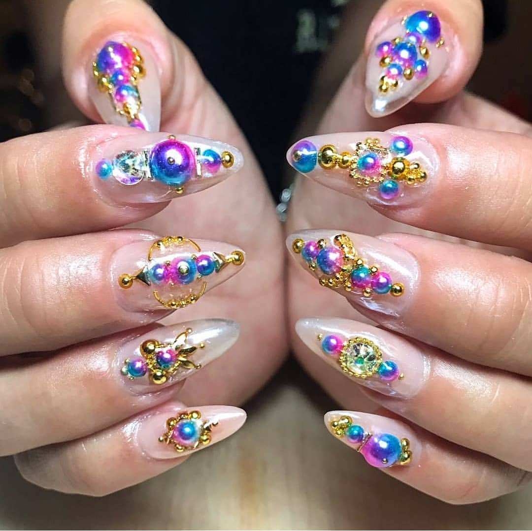 Another fun set! Love the colorful bubble effect. By  .....nailstagram