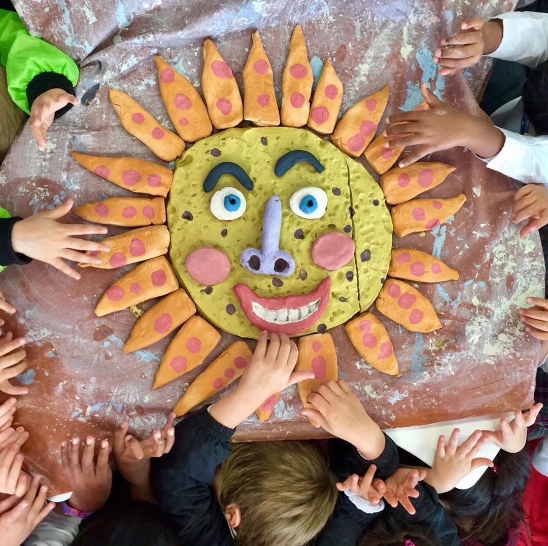 Noticing 23: red, yellow and blue.Kindy sun! Made by 5 year old kids. .ceramicsculpture