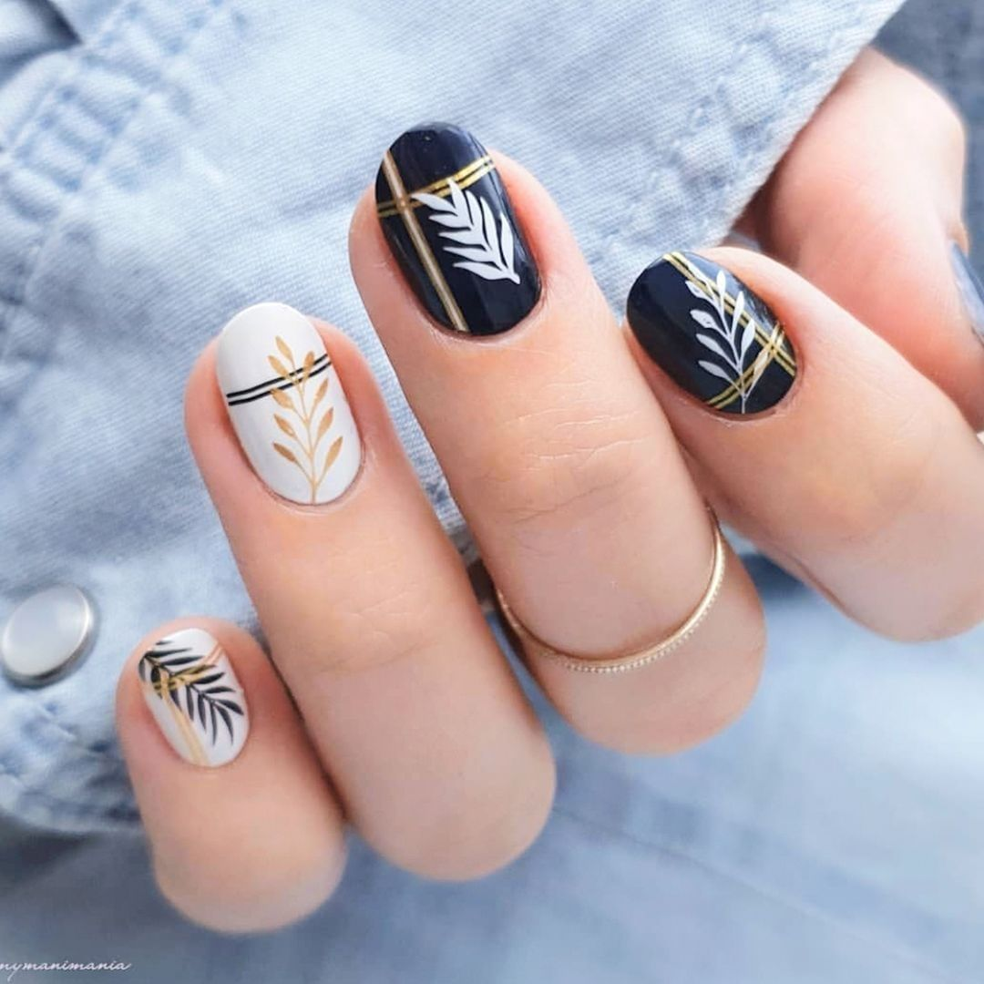Brilliant mani by Mixing the gold with a really dark blue creates a very refined look! Plates - Tropical 36  Holy Shapes 19  Mother Nature 15nailstop