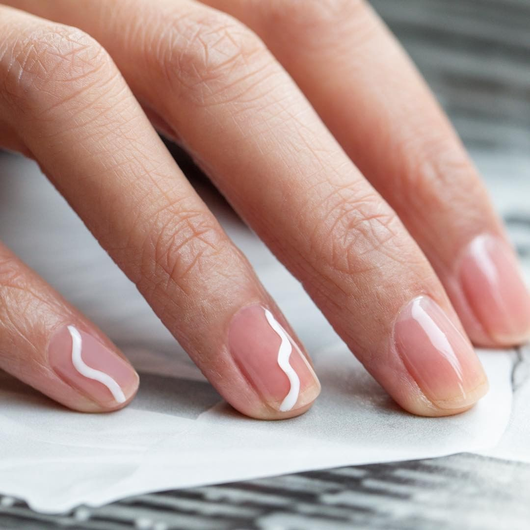 hen you want nothing except a little something, try this design by Nails by Corina using Clearly Pink and Cream Puff.