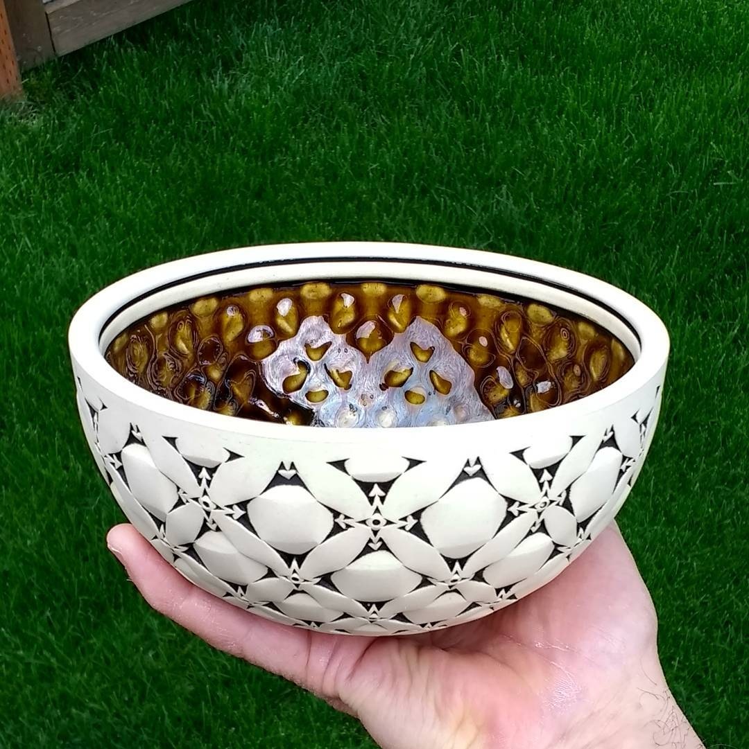 A nice medium size bowl with a shiny amber glaze I haven't used in a very long time.  surfacedesigner.