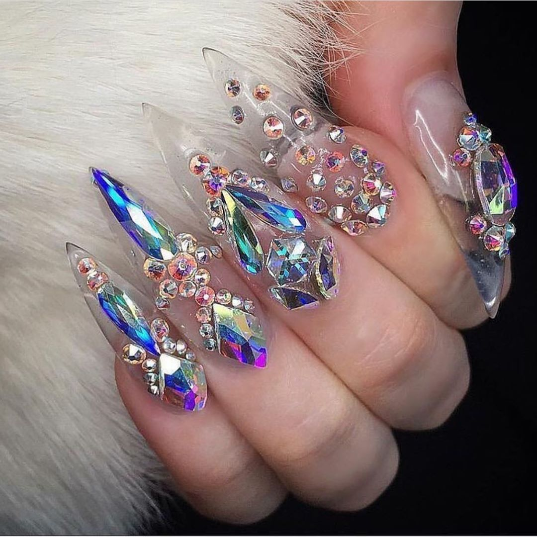 Yay or nay? Too much bling or just perfect?  Get 20% off $100+ Swarovski crystals at DailyCharme.com this week!  Use code DAZZLE20 ..Nail credit:  claws