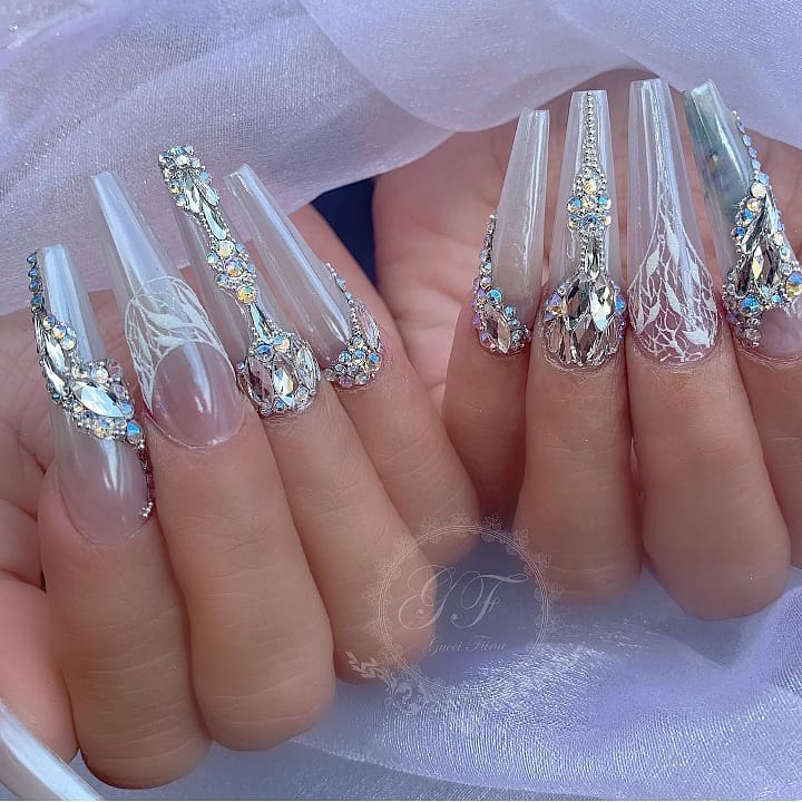 Amazing nails by  Featured Magic White Chrome Powder and Swarovski crystals are available at DailyCharme.com! WhiteNails
