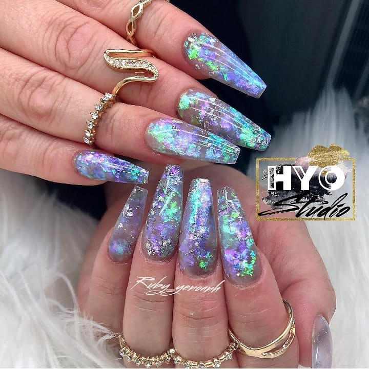 These nails by are super pretty!  Create this look with our iridescent flakes, available at DailyCharme.com